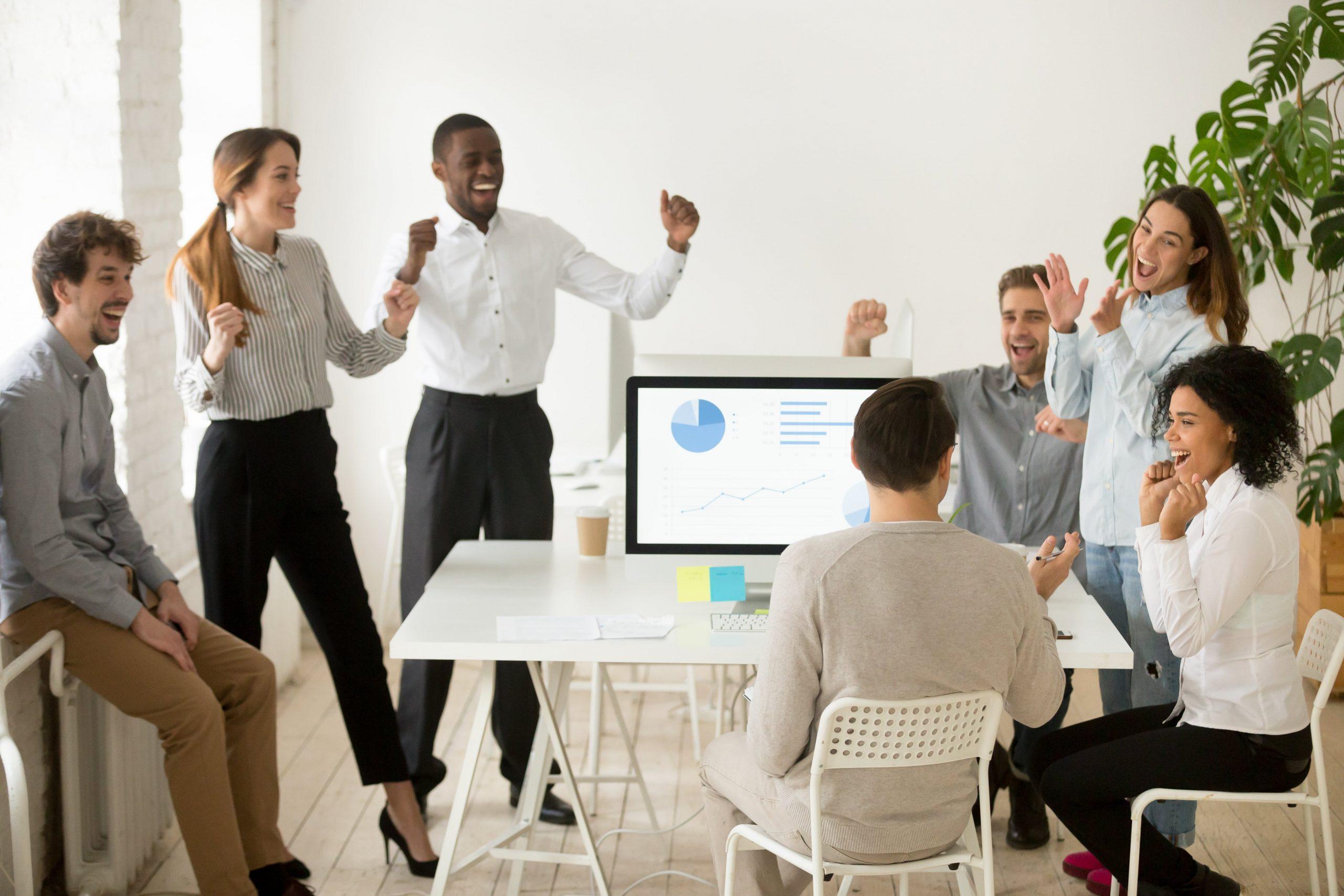 employees celebrating work success - employer benefits UK