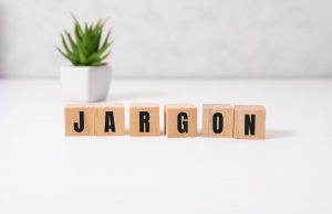 "Wooden blocks on a table spelling out the word ""jargon"""